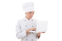Young woman chef  in uniform with laptop isolated on white Stock Image