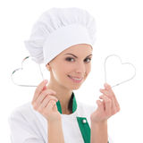 Young woman in chef uniform with metal heart shaped cookie cutte Stock Photos