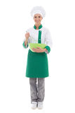Young woman in chef uniform mixing something in green plastic bo Stock Images