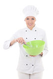 Young woman in chef uniform mixing something in green plastic bo Stock Photography