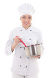 Young woman in chef uniform mixing something in saucepan isolate Royalty Free Stock Photography