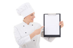 Young woman in chef uniform showing clipboard with blank paper i Stock Images