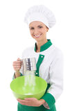 Young woman in chef uniform sifting flour into a bowl isolated o Royalty Free Stock Images