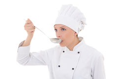 Young woman in chef uniform tasting something isolated on white Stock Photo