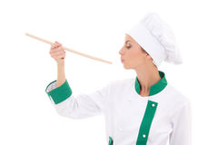 Young woman in chef uniform tasting something isolated on white Stock Images
