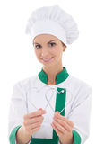 Young woman in chef uniform with two metal heart shaped cookie c Stock Photos