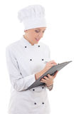 Young woman in chef uniform writing something in clipboard isola Stock Images