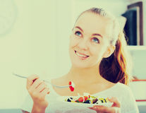 Young woman with chestnut hair eating salad Royalty Free Stock Images