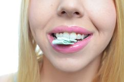 Young woman chewing gum. Young woman chewing mint gum Stock Photo