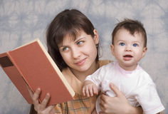 The young woman with the child Stock Image