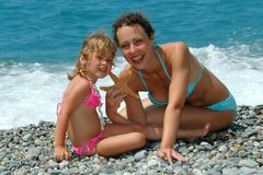 The young woman and child on a beach Stock Images