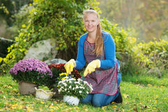 Young woman with a child are planting flowers Royalty Free Stock Images