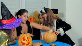 Young Woman With Children Carving Halloween stock footage