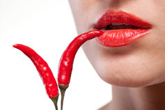 Young woman with chili pepper on white. Young woman with chili pepper isolated on white stock photo