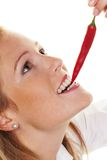 Young woman with Chilli Stock Photography