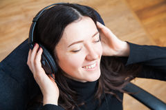 Young woman chilling at home in headphones. Relax with music Royalty Free Stock Image