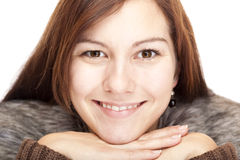 Young Woman with chin on hands smiles happy Stock Photography