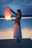 Young woman with a chinese sky lantern stock images