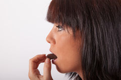 The young woman and chocolate Royalty Free Stock Images