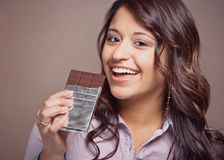 Young woman with chocolate bar. Beautiful happy young woman with chocolate bar Royalty Free Stock Photos