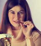 Young woman with with a chocolate Royalty Free Stock Image