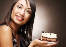 Young woman with chocolate cake Royalty Free Stock Photo