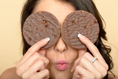 Young Woman With Chocolate Rice Cakes Over Eyes Royalty Free Stock Photo