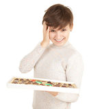 Young woman with chocolates Stock Photo