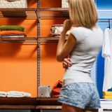 Young woman chooses clothes in wardrobe. royalty free stock photos