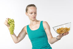 Young woman chooses healthy food Stock Photos