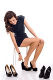 Young woman chooses shoes Stock Images