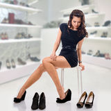 Young woman chooses shoes Stock Image