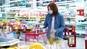 Young woman choosing cheese at grocery store during COVID
