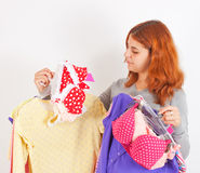 Young woman choosing clothes Stock Photos