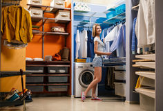 Young woman choosing clothes for husband Stock Images