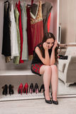 The young woman choosing clothing for evening party. Young woman choosing clothing for evening party Royalty Free Stock Photography