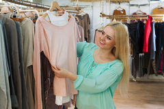 Young woman choosing cloths Royalty Free Stock Photography