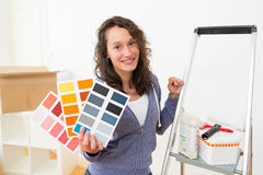Young woman choosing colors of their new flat Stock Photo