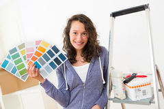 Young woman choosing colors of their new flat Royalty Free Stock Photography