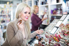 Young woman choosing face powder Stock Image