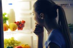 Young woman choosing food Royalty Free Stock Photo