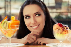 Young Woman Choosing Between Fruit Salad and Ice Cream Desserts Stock Images