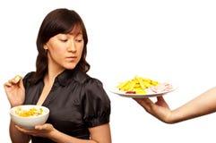 Young woman choosing between healthy salad and fri royalty free stock photos