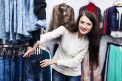 Young Woman choosing jeans Royalty Free Stock Photography