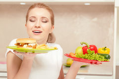 Young woman choosing lunch Stock Photo