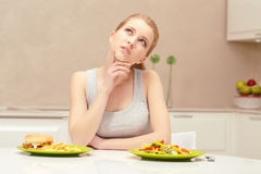 Young woman choosing lunch Royalty Free Stock Photo
