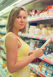 Young woman choosing meat. Young woman choosing meat in grocery store Stock Photos