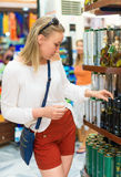 Young woman choosing olive oil. Royalty Free Stock Photo