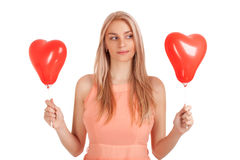 Young woman choosing one of balloons Stock Photo