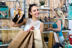 Young woman choosing a pair of shoes Stock Image